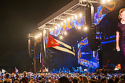 HAVANA, CUBA - MARCH 25, 2016: A Cuban flag waves in the crowd as The Rolling Stones perform at Ciudad Deportiva on March 25, 2016 in Havana, Cuba. The Rolling Stones performance is the first by a major international rock band in Cuba, coming days after a historic visit by President Barack Obama of the United States, and a game between the Tampa Bay Rays and the Cuban National Team at Estadio Latinoamericano. The Cuban government banned rock music on Cuban state TV and radio following the Cuban the revolution, and nearly a half-million people are in attendance to be part of the historic event. (Photo by Jean Fruth)