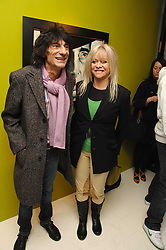 RONNIE & JO WOOD at an exhibition of artist Paul Karslake's work entitled Ideas & Idols, held at Scream, 34 Bruton Street, London W1 on 21st February 2008.<br />