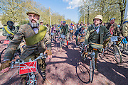"Passing Buckingham Plaace. The Tweed Run 2015 - it's 7th annual British public bicycle ride through London's historic streets, with a prerequisite that participants are dressed in their best tweed cycling attire. There are also plenty of handle bar moustaches, penny farthings and Union Jacks. ""Guests can expect a leisurely day cycling, stopping at some of London's most iconic landmarks to enjoy a spot of tea, a picnic in the park and finally a jolly good knees-up in a beautiful art-deco ballroom for the Tweed Run closing ceremony. Starting at Trafalgar Square, the cyclists then embarked on a 12 mile scenic ride through London, stopping at traditional spots."