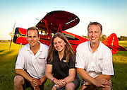 Ben Redman, his wife Karen, and his brother Jeremy.  They are principals in the WACO restoration business founded by Jeremy's father, Rare Aircraft.   Created during AirVenture 2010, in Oshkosh, Wisconsin.