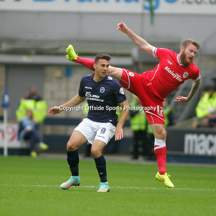 25 October 2014 - Sky Bet Championship - Millwall v Cardiff City - Aron Gunnarsson of Cardiff raises his leg above the heighth of Lee Gregory.<br /> <br /> <br /> Photo: Ryan Smyth/Offside