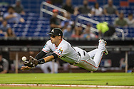 Miami Marlins third baseman Martin Prado (14) dives for a catch during the 5th inning of the game against the Los Angeles Dodgers at Marlins Park in Miami on Tuesday, May 15, 2018