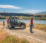 Family viewing waterfall during ATV ride on Trapper Creek Road along the Lower Goose Creek Reservoir near Oakley, Idaho.