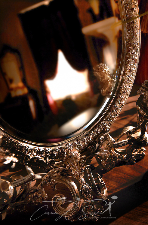 An ornate, antique silver mirror reflects a bedroom at Shadowlawn bed and breakfast, Oct. 12, 2006, in Columbus, Mississippi. (Photo by Carmen K. Sisson/Cloudybright)