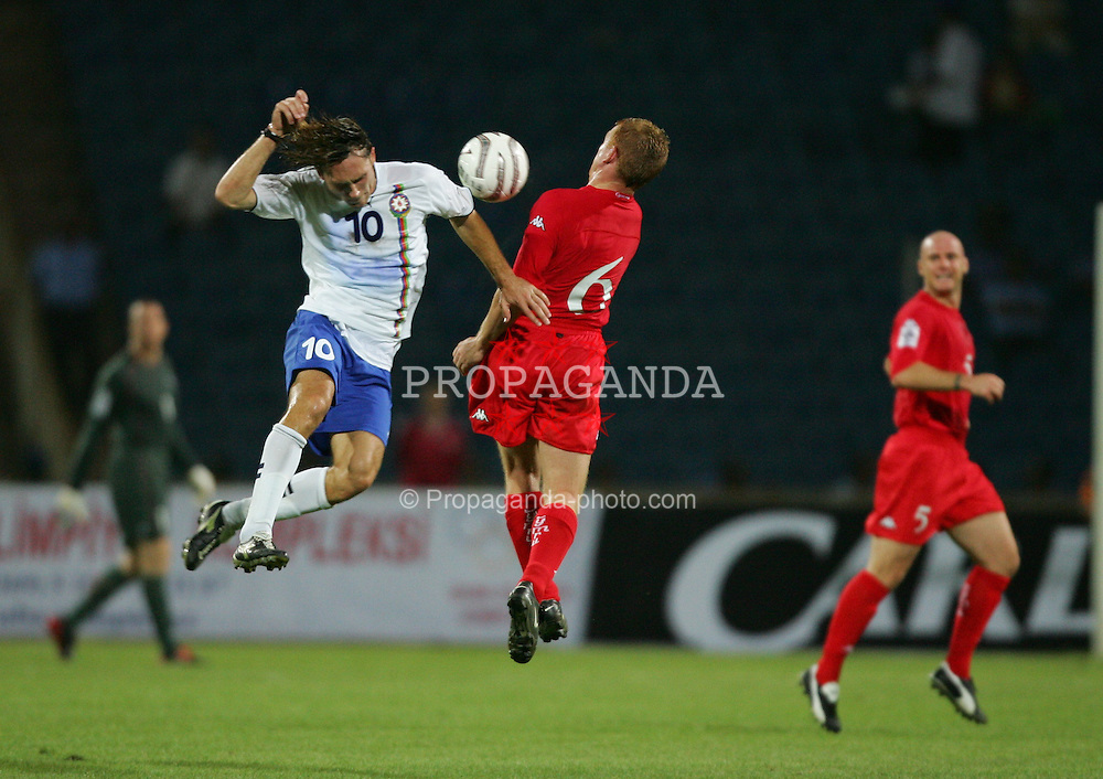 BAKU, AZERBAIJAN - SATURDAY SEPTEMBER 4th 2004: Wales' Mark Pembridge and Azerbaijan's Anatoli Ponomaryov during the opening Group Six World Cup Qualifyer at the Tofig Bahramov Republican Stadium in Baku. (Photo by David Rawcliffe/Propaganda)