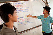 Ethnic Shan youths presents material learned at a two-day training on HIV/AIDS prevention run by Shan Youth Power (SYP) at Ban Wiang Wai, Chiang Mai, Thailand on July 16, 2011.