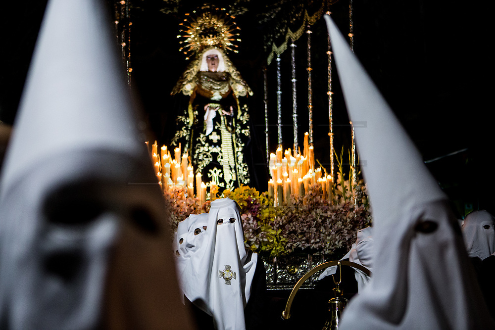 The femenine brotherhood with white capirote carrying the Virgin of Sorrows. General Procession of Good Friday considered<br /> Cultural Heritage of Mataró city (Barcelona, Spain) since 2013.  Easter 2015. Eva Parey/4SEE