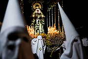 The femenine brotherhood with white capirote carrying the Virgin of Sorrows. General Procession of Good Friday considered<br /> Cultural Heritage of Matar&oacute; city (Barcelona, Spain) since 2013.  Easter 2015. Eva Parey/4SEE