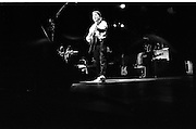 "Paul Simon In Concert.  (R54)..1987..16.04.1987..04.16.1987..16th April 1987..As part of his world tour of ""Graceland"", Paul Simon took to the stage of the RDS last night. A packed house was treated to songs from his current album as well as some classics from the Simon and Garfunkel catalogue...Picture shows Paul Simon performing a song from his album ""Graceland"" on stage at the RDS."