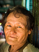 22 OCTOBER 2015 - YANGON, MYANMAR:  A man who used to be a sailor on ocean freighters and now works as a stevedore on the Yangon riverfront.    PHOTO BY JACK KURTZ