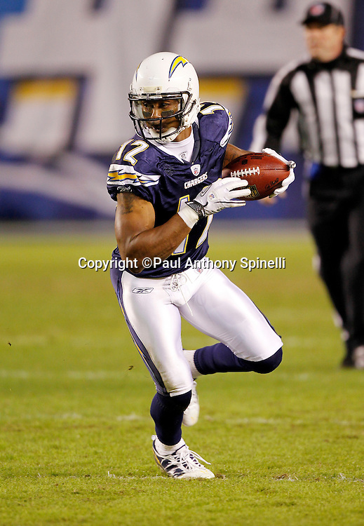 San Diego Chargers wide receiver Patrick Crayton (12) catches a pass and runs for a second quarter touchdown that gives the Chargers a 21-0 lead during the NFL week 11 football game against the Denver Broncos on Monday, November 22, 2010 in San Diego, California. The Chargers won the game 35-14. (©Paul Anthony Spinelli)