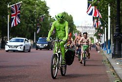 © Licensed to London News Pictures. 08/06/2019. London, UK. Nude demonstrators cycle down the Mall as part of the World Naked Bike Ride Day. The event aims to raise issues surrounding the safety of cyclists on the road, reducing oil dependence and saving the planet. Photo credit : Tom Nicholson/LNP