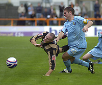 Photo: Matt Bright.<br /> Barnet v Mansfield Town. Coca Cola League 2. 13/10/2007.<br /> Liam Hatch of Barnet is fouled by Jake Buxton of Mansfield Town