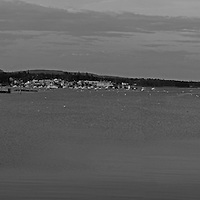 B&W Maine panorama photography of Southwest Harbor, nestled into the granite seacoast away from the Atlantic Ocean on Mount Desert Island. This harbor as part of small coastal villages along the coastal areas of MDI is quintessential Maine. <br />