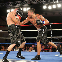Aaron Jaco (blue gloves) beats Angel Martinez during a Telemundo boxing match at the A La Carte Pavilion  on Friday, August 1, 2014 in Tampa, Florida. (AP Photo/Alex Menendez)