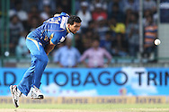 Rishi Dhawan of Mumbai Indians sends down a delivery during match 19 of the Karbonn Smart Champions League T20 between the Perth Scorchers and the Mumbai Indians held at the Feroz Shah Kotla Stadium, Delhi on the 2nd October 2013<br /> <br /> <br /> Photo by Shaun Roy-CLT20-SPORTZPICS <br /> <br /> Use of this image is subject to the terms and conditions as outlined by the CLT20. These terms can be found by following this link:<br /> <br /> http://sportzpics.photoshelter.com/image/I0000NmDchxxGVv4