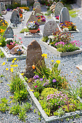 Churchyard in the Engadine Valley village of Guarda, Switzerland