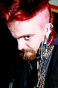 A goth making the hole in his ear worse, UK September 2005