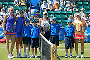 Jocelyn RAE (GBR), Laura ROBSON (GBR), Monique Adamckzak (AUS) andStorm Sanders (AUS) pose for photos with their walk-on buddies during the WTA Woman's Doubles final of the Aegon Open Nottingham at Nottingham Tennis centre, Nottingham, United Kingdom on 18 June 2017. Photo by Jon Hobley.