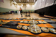 """Championship belts waiting to be won are seen backstage at Championship Wrestling Entertainment's Live Pro Wrestling event at the Port St. Lucie Civic Center on Friday, May 15, 2015. CWE is a local """"indie"""" wrestling company headquartered in Port St. Lucie. (XAVIER MASCAREÑAS/TREASURE COAST NEWSPAPERS)"""