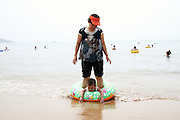 A woman and a child at the beach in Qingdao, China.
