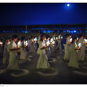 The Buddhist faithful gather on the full moon for prayers and world peace at Wat Dhammakaya , Feb. 18, 2010, in Bangkok, Thailand.