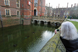 © Licensed to London News Pictures. 01/08/2014. The usually dry moat at Hampton Court Palace has water in it because of the swollen Thames. Recent bad weather has caused the river Thames in south west London and Surrey to reach very high levels. Credit : Rob Powell/LNP