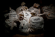 Old money bags on exhibit inside the Federal Hall. The Federal Hall was the first toll house in New York and also the site of the stock exchange before it moved across the street to where NYSE Euronext Stock Exchange is today.