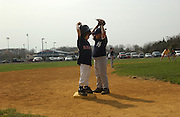 Adam Jones, age 7, stands on third base, as he plays little league in Toms River, NJ.                      <br /> Adam Jones, age 7, and Jeffrey Jones, age 9, are two brothers out of 6 siblings that have different forms of autism . Their family integrates them into all forms of daily life, which include little league, physical therapy, private tutoring sessions and family meals. Every year it costs around $50,000 per child to get them the help they need to become more socialized.