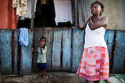 Regina Ansah, 34, stands outside her home in Ghana's capital Accra as she prepares to go vote during presidential and parliamentary elections on Sunday December 7, 2008. A mother of 4, Ansah says the abolition of school fees and the introduction of school feeding programmes by the ruling party convinced her to once again vote for them..