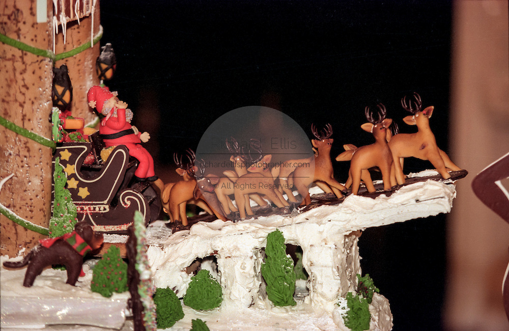 Santa and his reindeers made from marzipan decorate a cake as First Lady Hillary Rodham Clinton unveils the White House Christmas decorations December 6, 1998 in Washington, DC