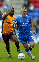Photo: Chris Brunskill. Wigan Athletic v Milwall. Coca-Cola Championship. 12/03/2005. Graham Kavanagh of Wigan and Barry Hayles of Millwall.