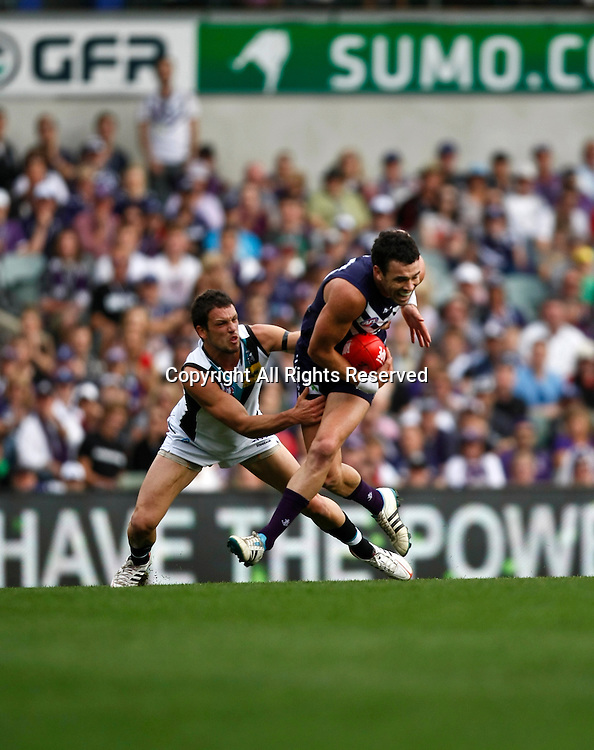 13.05.2012 Subiaco, Australia. Fremantle v Port Adelaide. Ryan Crowley marks in front of Travis Boak during the Round 7 game played at Patersons Stadium.