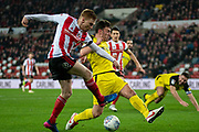 Duncan Watmore of Sunderland FC shoots at goal but is blocked during the EFL Sky Bet League 1 match between Sunderland and Burton Albion at the Stadium Of Light, Sunderland, England on 26 November 2019.