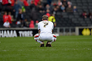 MK Dons midfielder Carl Baker cuts a dejected figure  during the Sky Bet Championship match between Milton Keynes Dons and Brentford at stadium:mk, Milton Keynes, England on 23 April 2016. Photo by Dennis Goodwin.