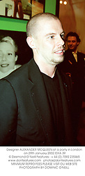 Designer ALEXANDER MCQUEEN at a party in London on 29th January 2002.OXA 39