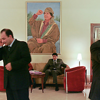 Businessmen outside a Visa International meeting this week in a hotel in Tripoli, Libya, under a portrait of Col. Muammar el-Qaddafi, who is celebrating the 30th anniversary of the system of government he instituted. There is much talk of economic, but not political, change. February 2007.
