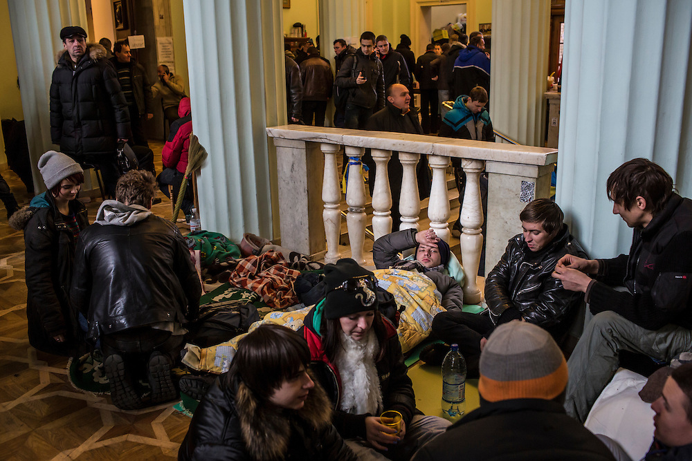 KIEV, UKRAINE - DECEMBER 4: Anti-government protesters rest on the floor in the occupied City Hall building on December 4, 2013 in Kiev, Ukraine. (Photo by Brendan Hoffman/Getty Images)