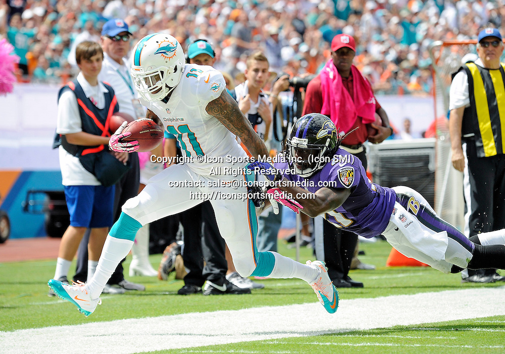 06 October 2013: Baltimore Ravens cornerback Lardarius Webb (21) tackles Miami Dolphins wide receiver Mike Wallace (11) in Baltimore's 26-23 victory at Sun Life Stadium, Miami, Florida.