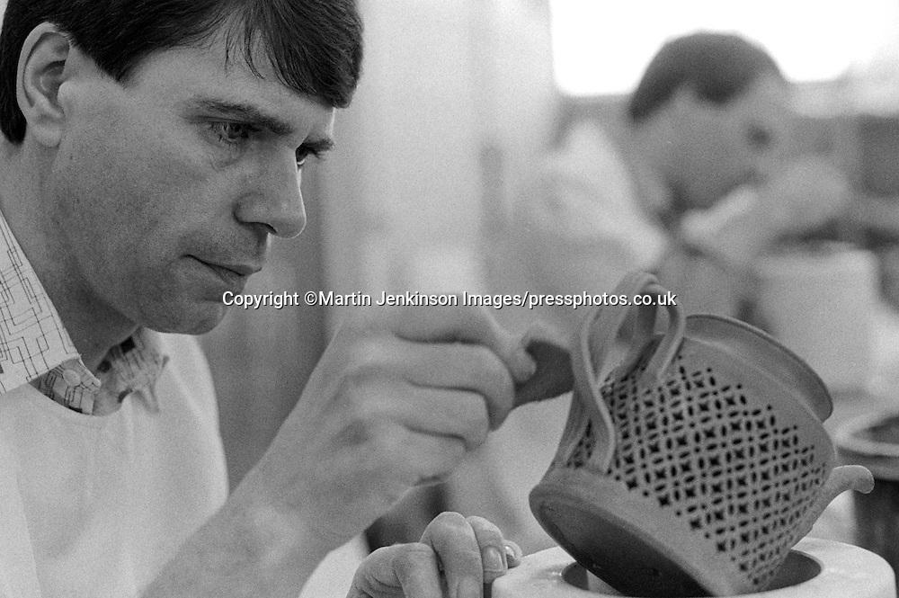 Potter making English creamware pierced tea pot at  Leeds Pottery.