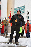 Richard Dalkeith, an organizer, makes speech in front of fifty people who gather in downtown Windsor, Ontario, Canada for the Colten Boushie prayer rally. Dalkeith asks many questions in his moving speech.