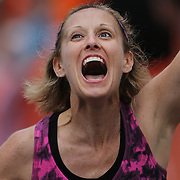 The Finish Line. Expressions of agony and ecstasy on the faces of athletes as Bonnie Appi, Northford, Connecticut, finishes the ING Hartford Marathon, Bushnell Park, Hartford. Connecticut. USA. Hartford, Connecticut, USA. 12th October 2013. Photo Tim Clayton