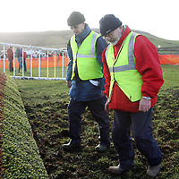 Mike O' Halloren and Hugh Dowling try to flatten out the ground before the next race at the 2007 Bellhabour Point to Point on Sunday.<br />