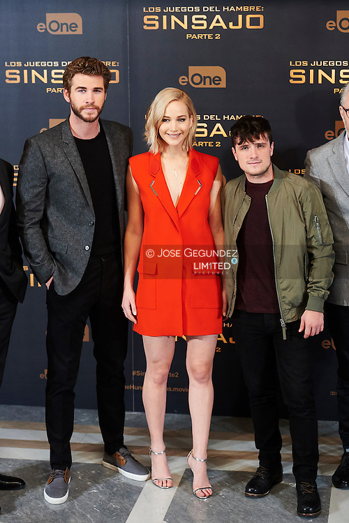 Liam Hemsworth, Jennifer Lawrence, Josh Hutcherson attended the 'Hunger Games: Mockingjay Part 2' Photocall at Villamagna Hotel on November 10, 2015 in Madrid
