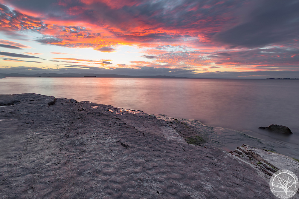 Beautiful sunset over Lake Champlain, as seen from Oakledge City Park, in Burlington, Vermont.