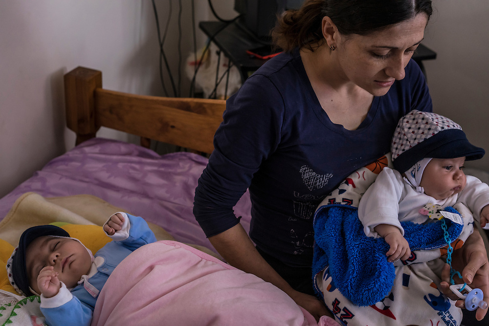 A mother with two small children who was displaced by recent fighting from her home in the city of Martakert speaks with foreign journalists in the hotel where she is temporarily being housed on Monday, May 9, 2016 in Stepanakert, Nagorno-Karabakh.