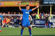 AFC Wimbledon striker Kweshi Appiah (9) with both hands in the air during the EFL Sky Bet League 1 match between AFC Wimbledon and Portsmouth at the Cherry Red Records Stadium, Kingston, England on 19 October 2019.