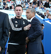 Managers Dougie Freedman and Chris Hughton during the Sky Bet Championship match between Brighton and Hove Albion and Nottingham Forest at the American Express Community Stadium, Brighton and Hove, England on 7 August 2015.