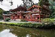 "The peaceful Byodo-In Temple is in Valley of the Temples Memorial Park, at 47-200 Kahekili Highway, Kaneohe, on the island of Oahu, Hawaii, USA. The Byodo-In Temple (""Temple of Equality"") was built in 1968 to commemorate the 100 year anniversary of the first Japanese immigrants to Hawaii. This Hawaii State Landmark is a non-practicing Buddhist temple which welcomes people of all faiths. The beautiful grounds at the foot of the Ko'olau Mountains include a large reflecting pond stocked with Japanese koi carp, meditation niches, and small waterfalls. Byodo-In Temple in O'ahu is a half-scale replica of the Byodo-in Temple built in 1053 in Uji, Japan (a UNESCO World Heritage Site)."