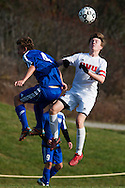 CVU's Brock Warner (4) and Mt. Anthony's Andew Griffin-Leon (4) leap to head the ball during the boys semifinal soccer game between Mount Anthony and Champlain Valley Union at CVU high school on Tuesday afternoon October 27, 2015 in Hinesburg. (BRIAN JENKINS/ for the FREE PRESS)